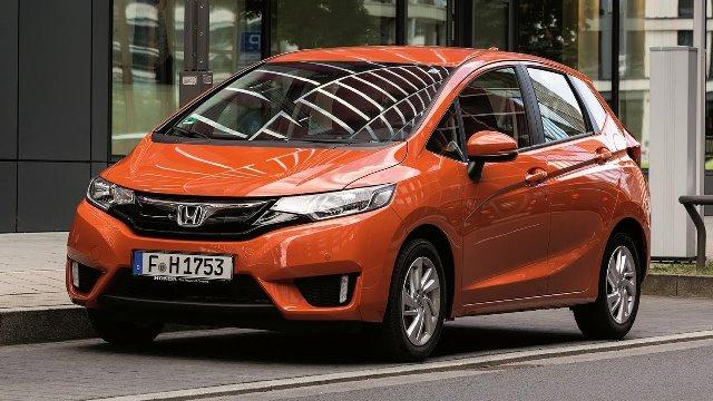 An orange Honda Jazz angular front view