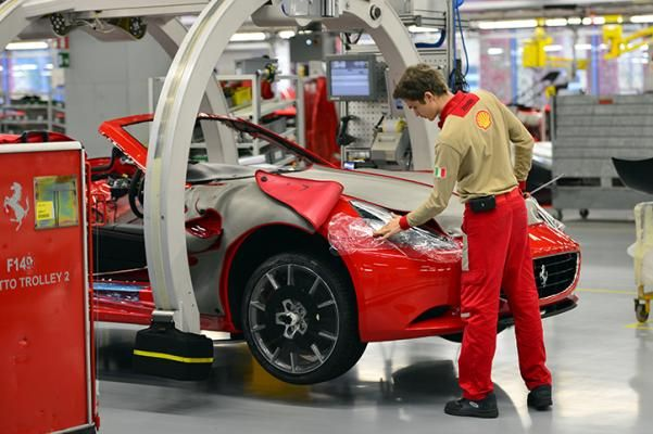 An employee at Ferrari car work