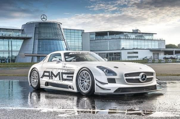 A white Mercedes in front of Mercedes-Benz World
