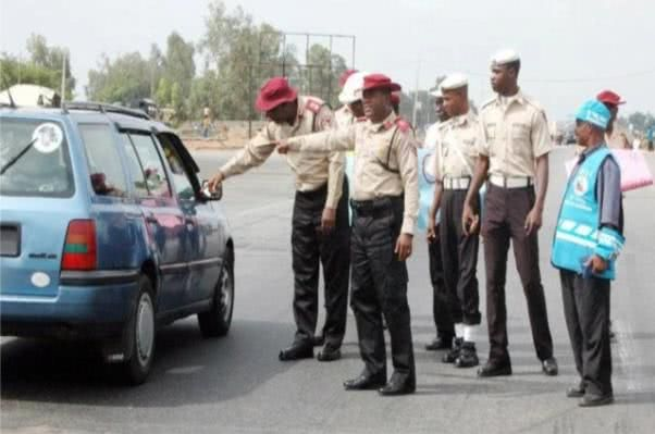 Nigerian polices checking a car on the road