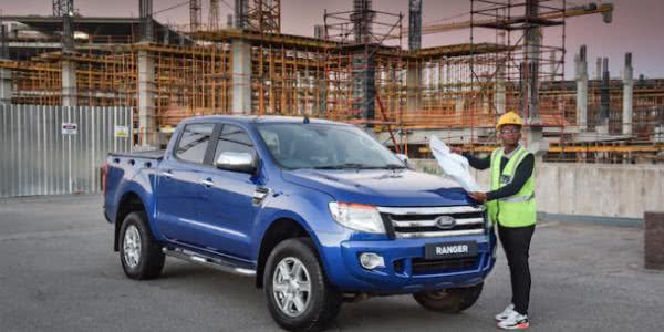 a Nigerian man with a blu Ford Ranger