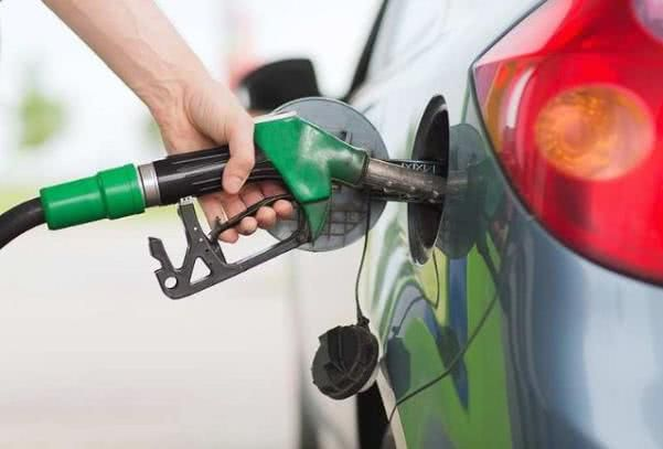 filling the tank for a car