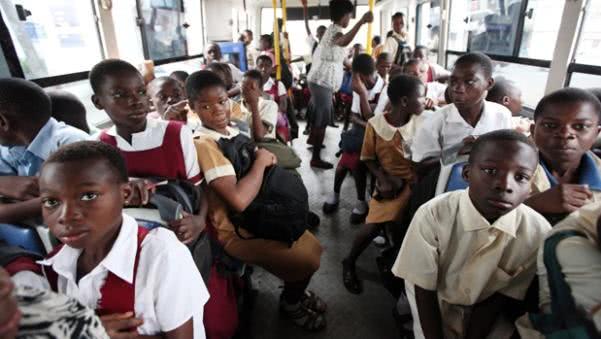 Many Nigerian children in a bus