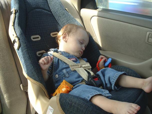 A baby sleeping in a car