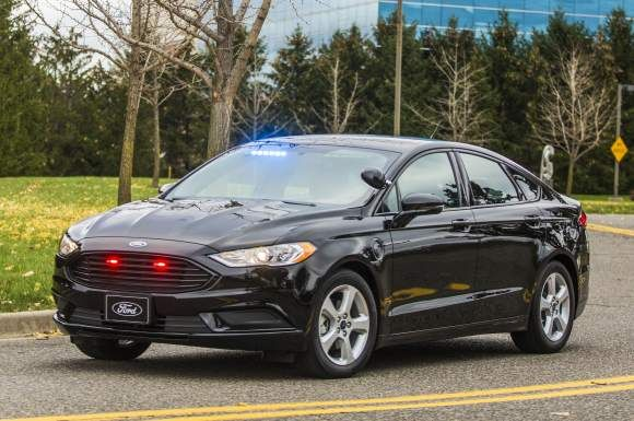Angular front of a Ford plug-in hybrid police sedan