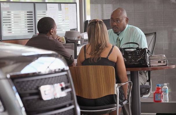 A car salesman listening to his customer