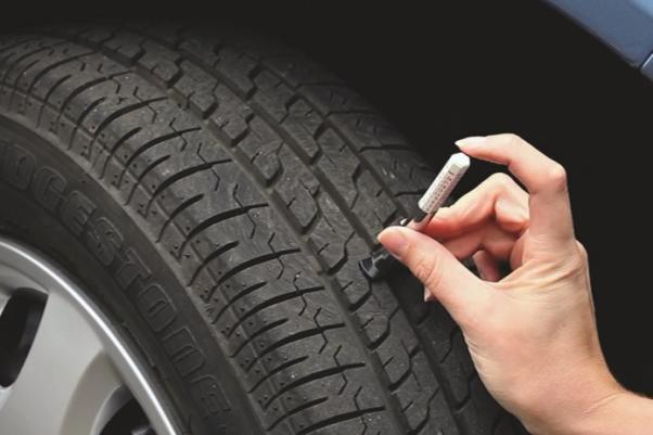 checking the tire tread