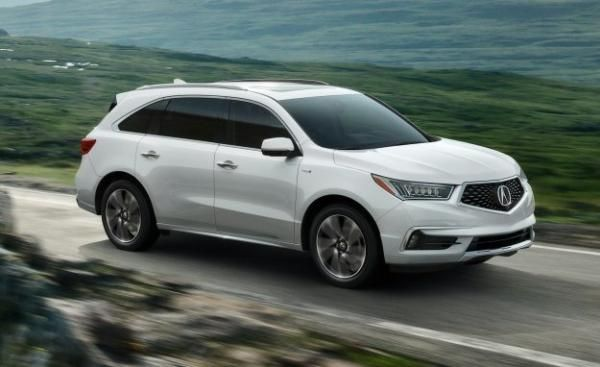 An Acura MDX on the road