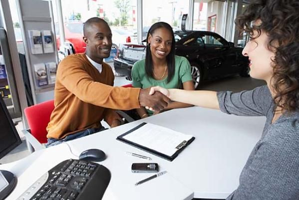 The buyers shake hands with the seller