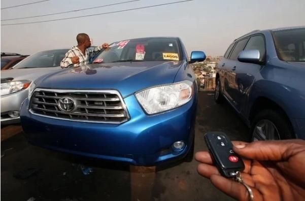 a man with an used Cotonou car