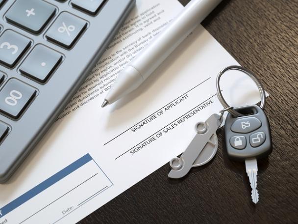car key, pen and car document.