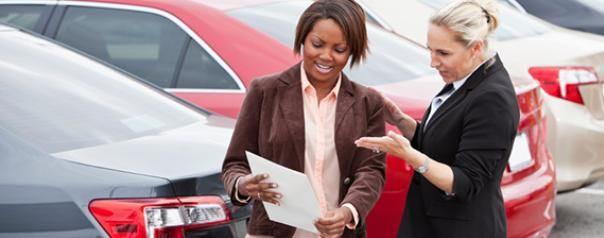 2 women check the customized paperwork