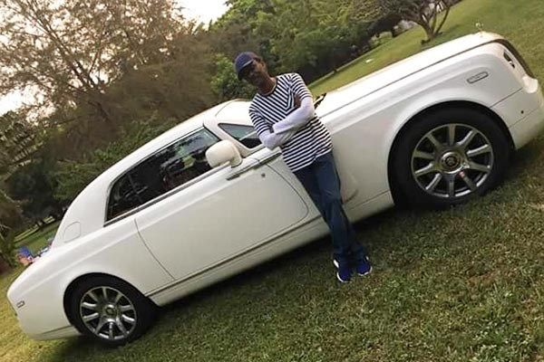 A man with his Rolls Royce