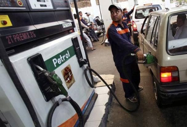 a man is filling fuel into the tank