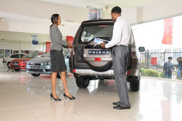 car salesman and buyer at dealer