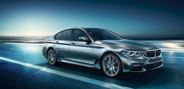 BMW 5 Series on the road