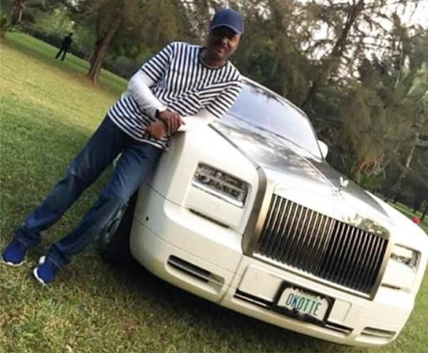 "Pastor Chris Okotie  stands by his car with the pricey personalized number plate ""OKOTIE"""