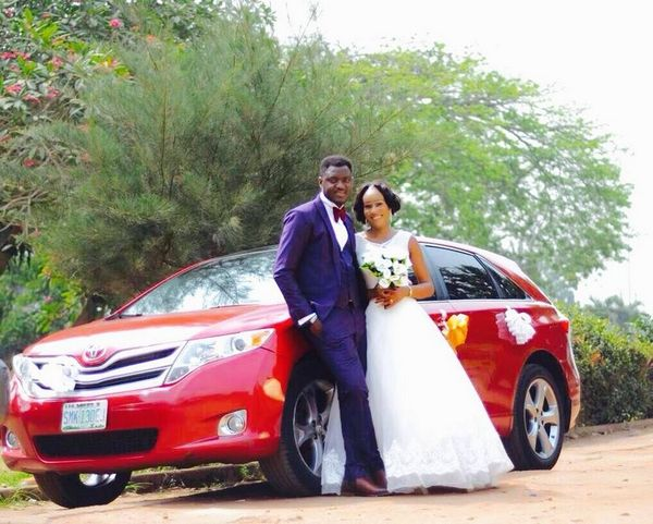 a Nigerian couple and their car