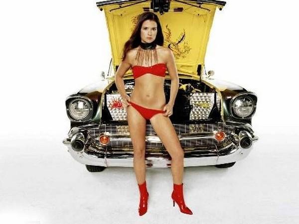 Danica Sue Patrick in front of a car