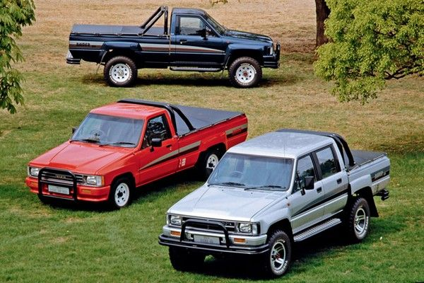Three of 8 generations of the Toyota Hilux