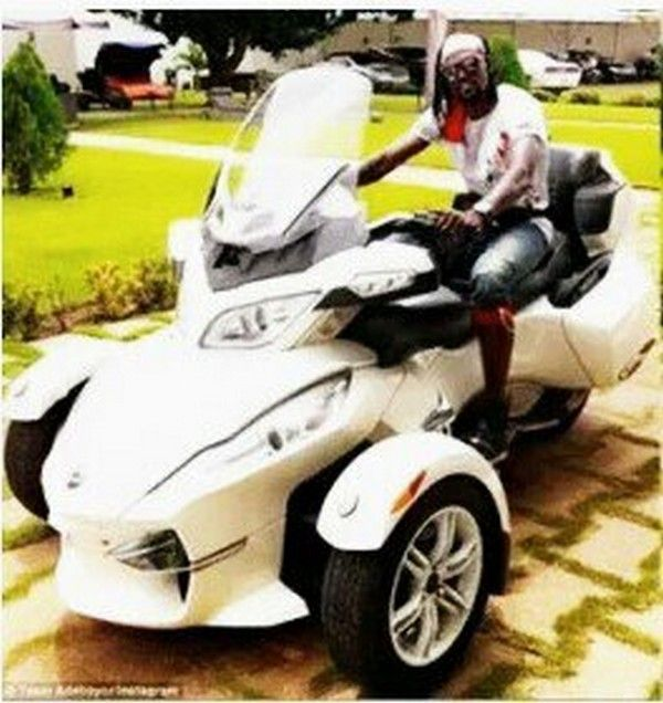 Emmanuel Adebayor drives his Can-Am motorcycle