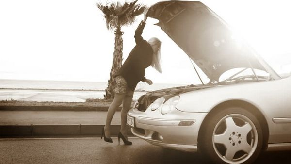 a girl in front of car hood