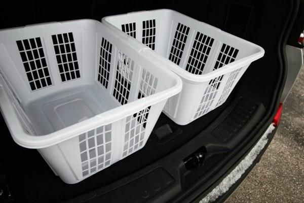 2 laundry baskets in a car boot