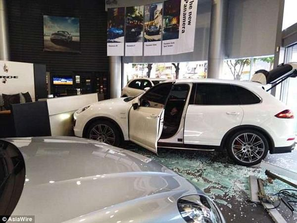 The furious businessman made a shocking decision to crash his vehicle into the dealership's entrance