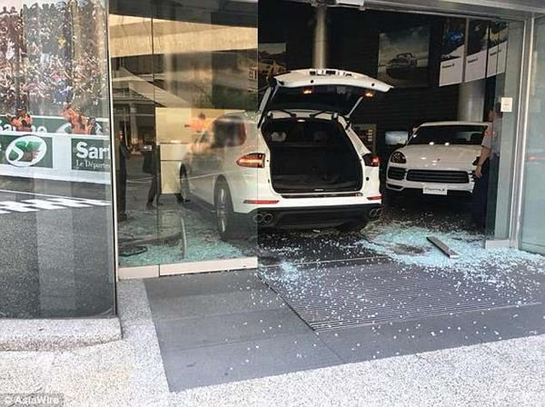 Chu drove in his Porsche into the glass front entrance breaking it into pieces