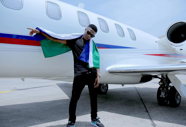 Wizkid beside his private jet