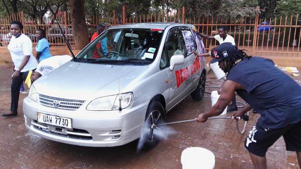 Men washing a car
