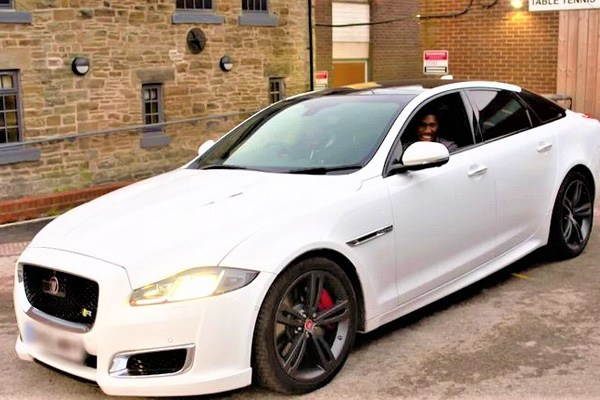 Anthony Joshua in his Jaguar XJR