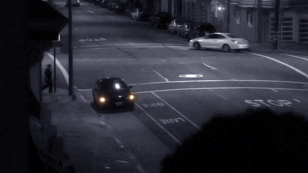 A car pulls over with hazard lights on