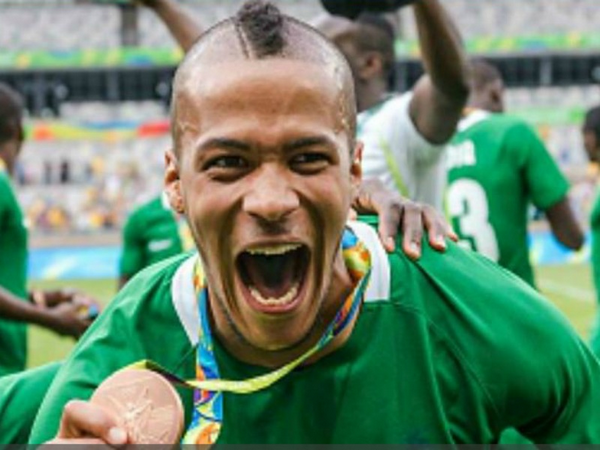 William Troost-Ekong shows off his medal