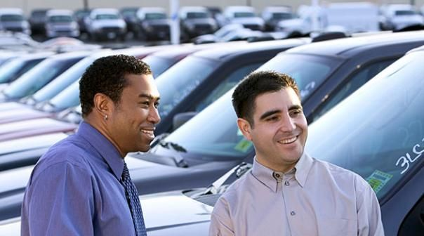 2 men buying a used car