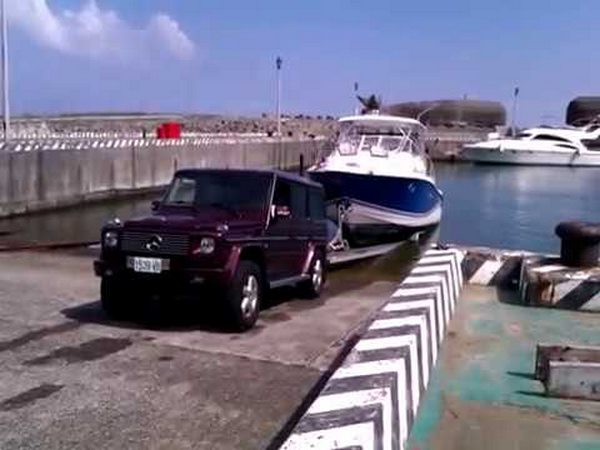A G-Wagon towing a boat