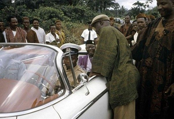 Dr. Nnamdi Azikiwe sitting in his car