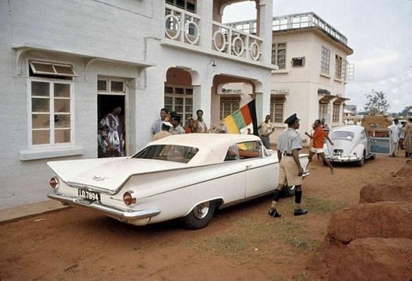 Nnamdi Azikiwe alongside his Volkswagen in 1959.