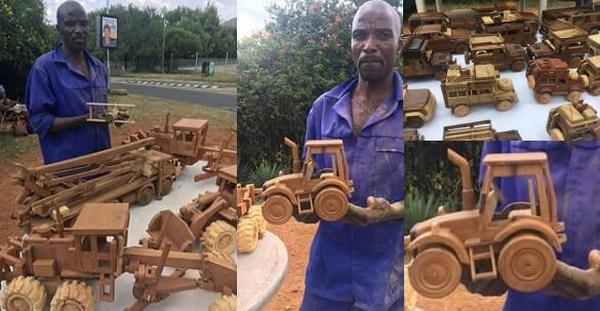 man making car models of wood