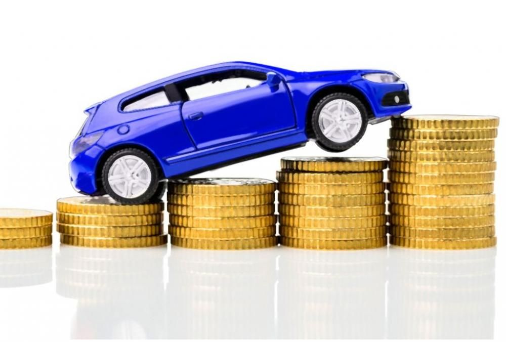 a car climbing a pile of coins