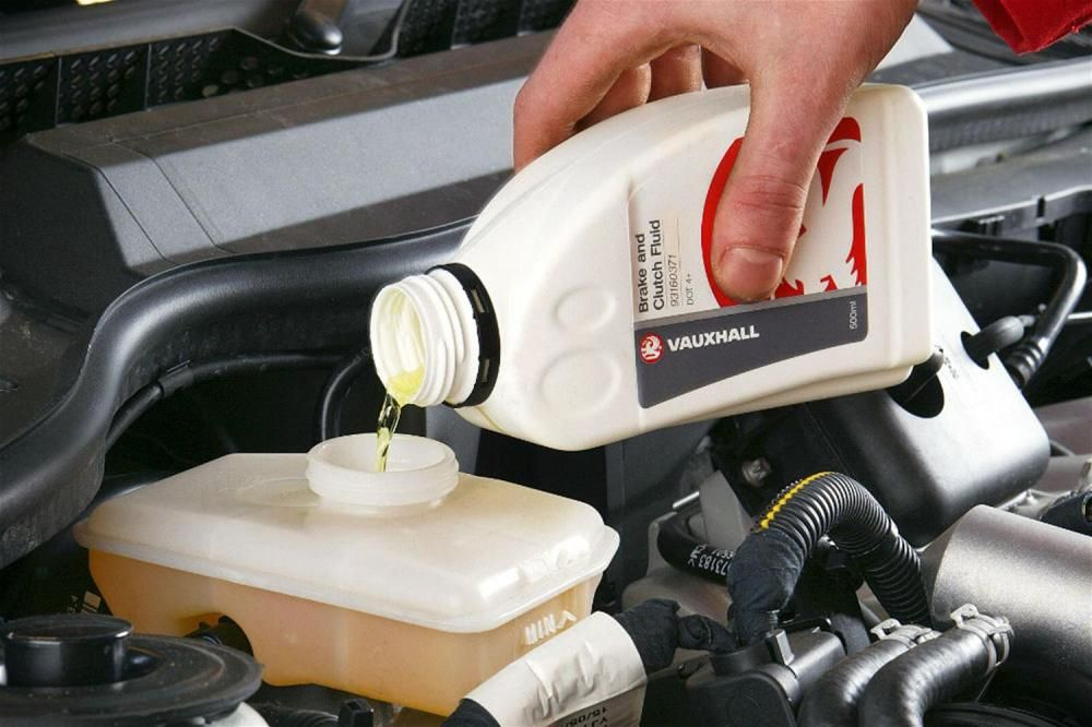 pouring-brake-fluid-into-car