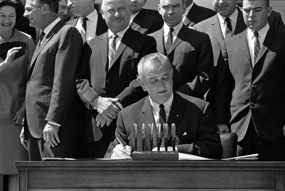 president Lyndon Johnson signing acts