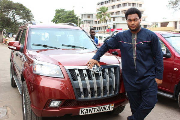 A man posing alongside a Kantanka vehicle