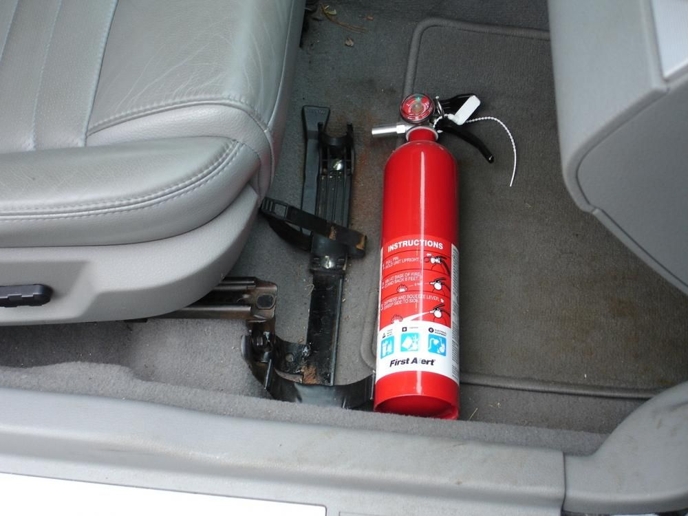 a fire extinguisher under a car's seat