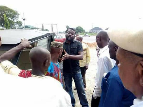 People gather around the Vehicle of Nigerian engineer Ephraim