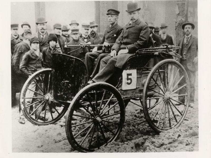2 men in their gas-powered car