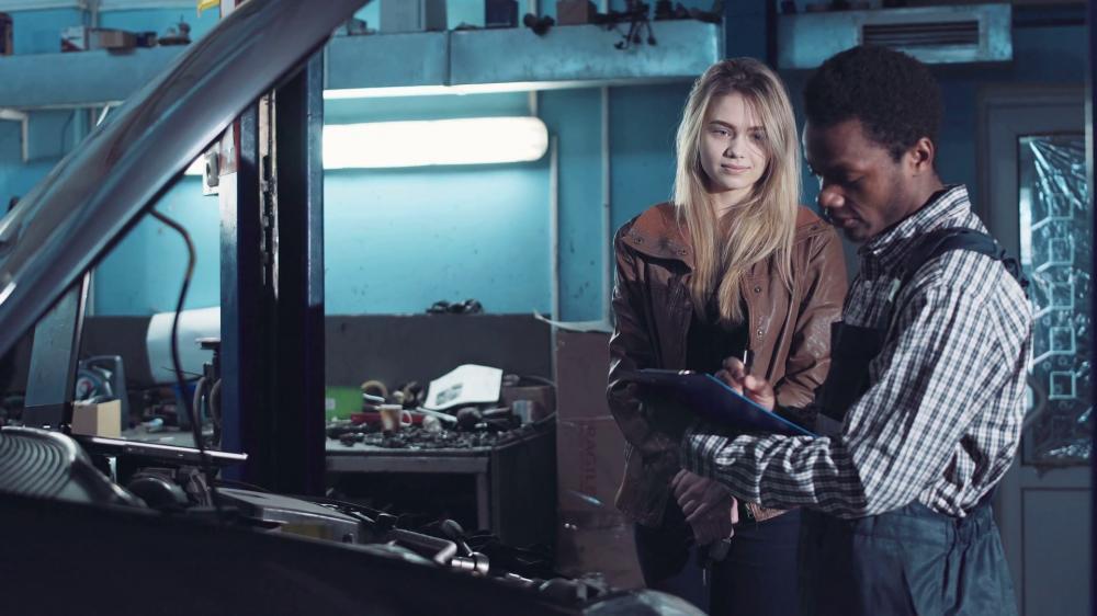 a white woman and a black mechanic