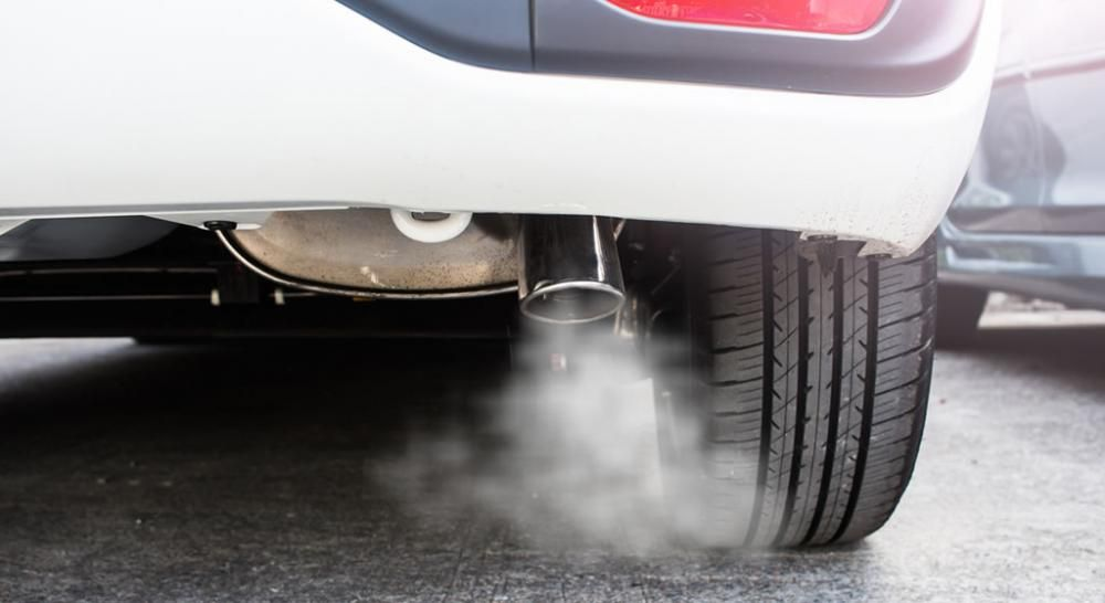 a car emitting thin white smoke