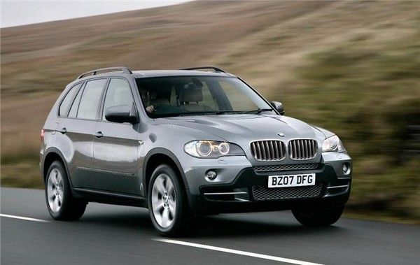 BMW X5 running on road