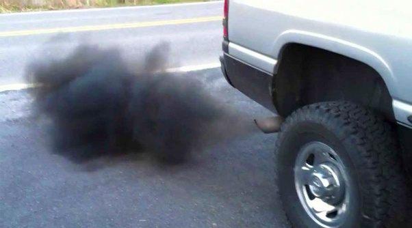 a car producing black smoke